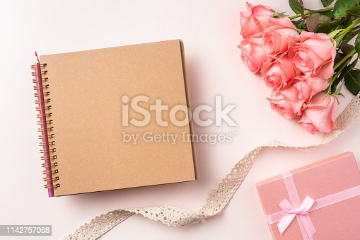 825251738istockphoto top view rose on pink for mothers , valentines day 1142757058