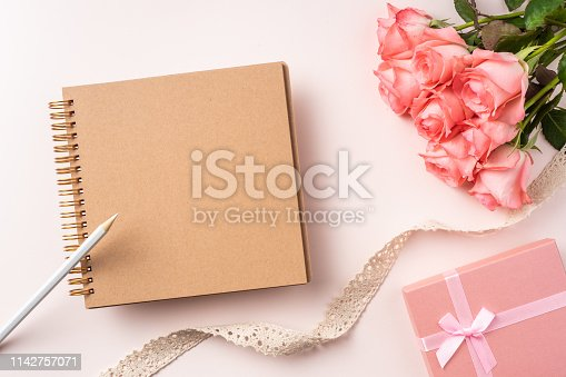 825251738istockphoto top view rose on pink for mothers , valentines day 1142757071