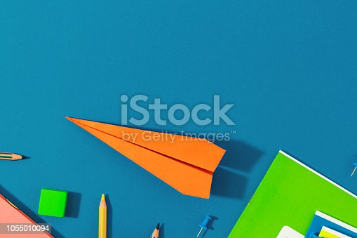 istock Top view school background Flat lay back to school paper airplane school supplies 1055010094