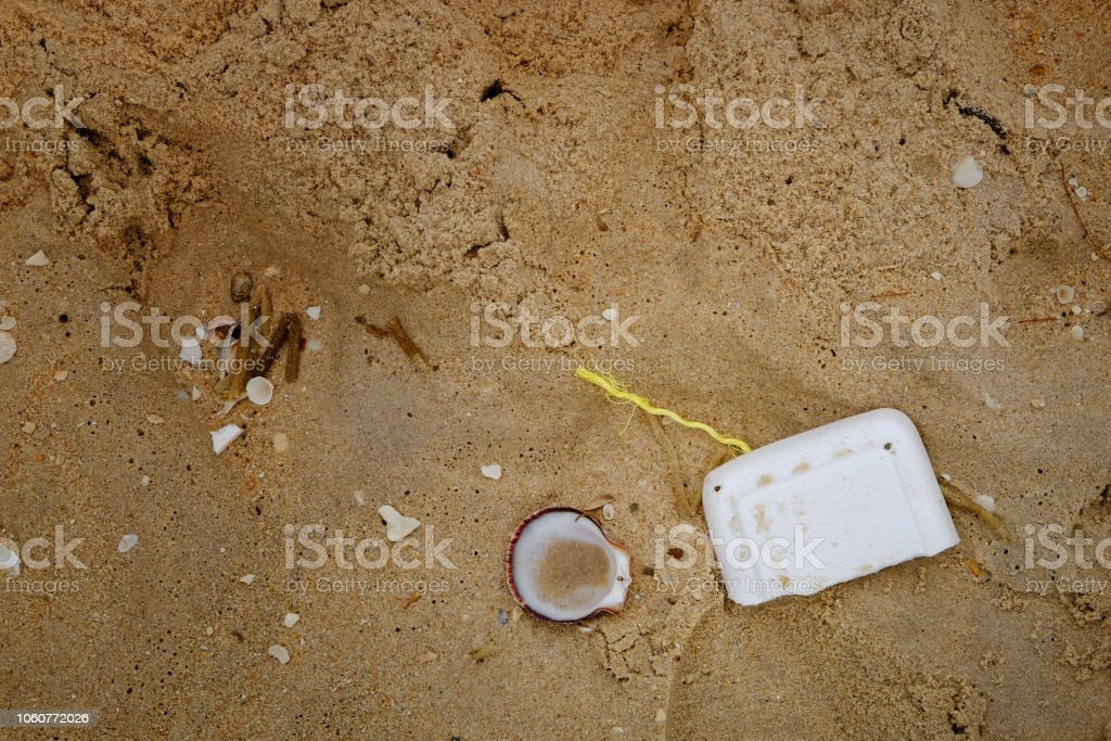 Top view sea pollution on sand. stock photo