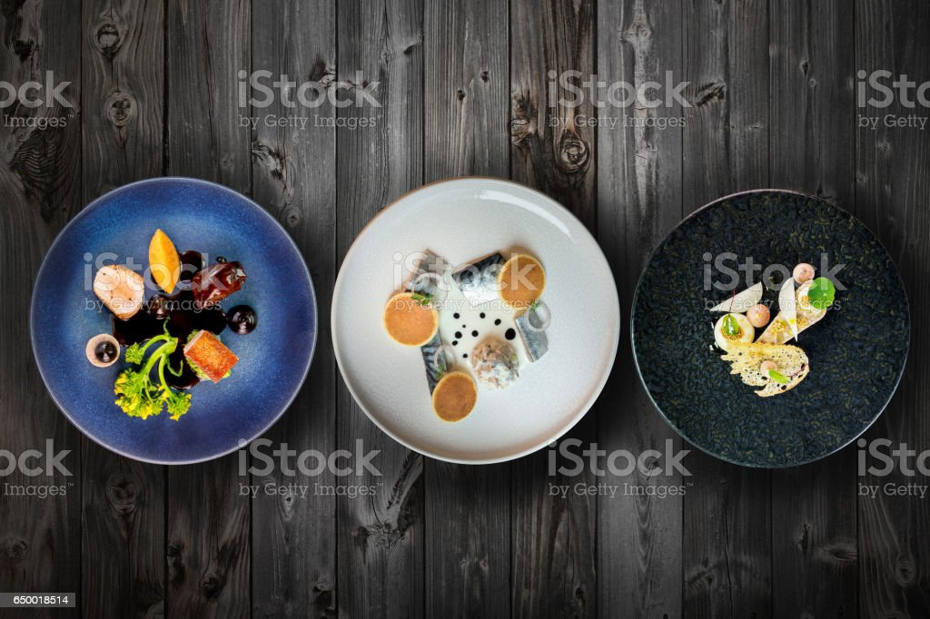 top view selection of fine dinning dishes on wooden table stock photo