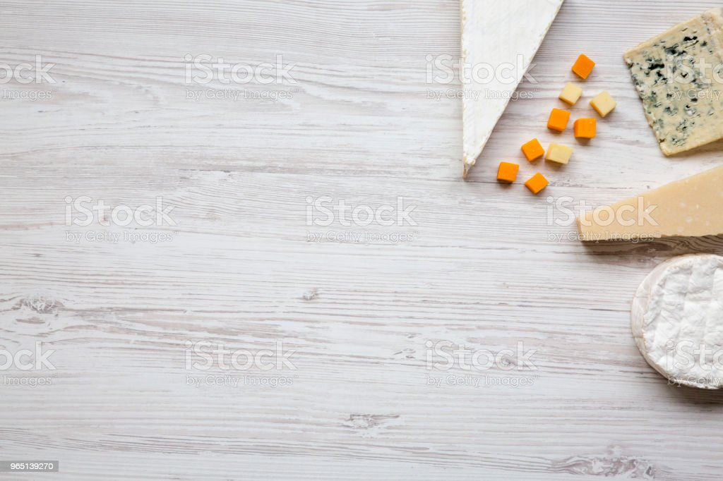 Top view, set of various cheese on a white wooden background. Copy space. Food for wine. Flat lay, from above. royalty-free stock photo