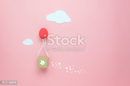 istock Top view shot of arrangement decoration Happy Easter holiday background concept.Flat lay colorful Easter egg balloon fly transfer blossom gift box on sky pink paper with cloud.Design pastel tone. 912145976