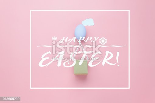 istock Top view shot of arrangement decoration Happy Easter holiday background concept.Flat lay colorful Easter egg balloon flying transfer gift box on sky pink paper with cloud at office desk.pastel tone. 915695222