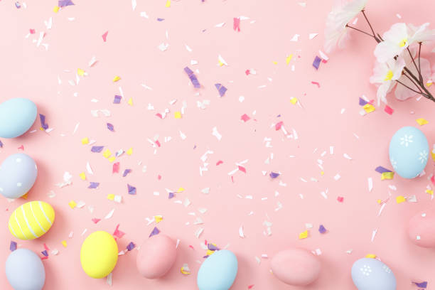Top view shot of arrangement decoration Happy Easter holiday background concept.Flat lay colorful bunny eggs with accessory ornament on modern beautiful pink paper at office desk.Design pastel tone. stock photo