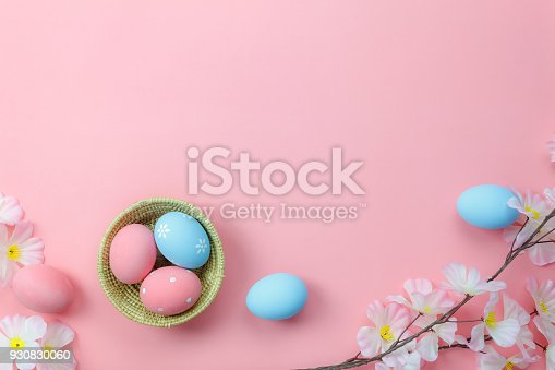 istock Top view shot of arrangement decoration Happy Easter holiday background concept.Flat lay colorful bunny eggs with accessory ornament floral on modern beautiful pink paper at office desk.pastel tone. 930830060
