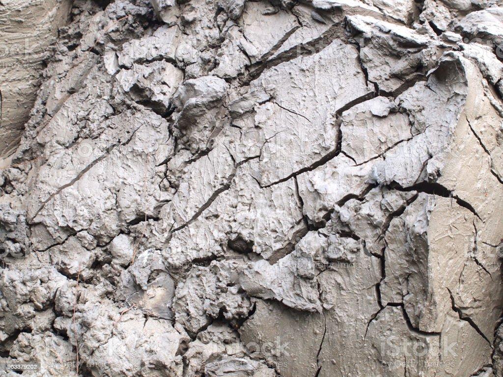 Top view shot of cracked soil - Zbiór zdjęć royalty-free (Ekonomia)