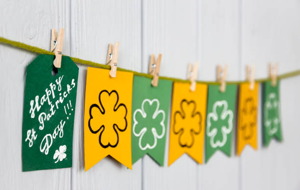 """top view. st patrick's day background. , march 17, flags with attributes with shamrocks clover and card with massage """"lucky"""" on clothespins on the wooden table background - happy st. patricks day stock photos and pictures"""