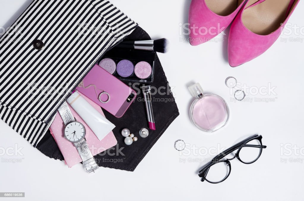 Top view striped clutch woman accessories and pink shoes . stock photo