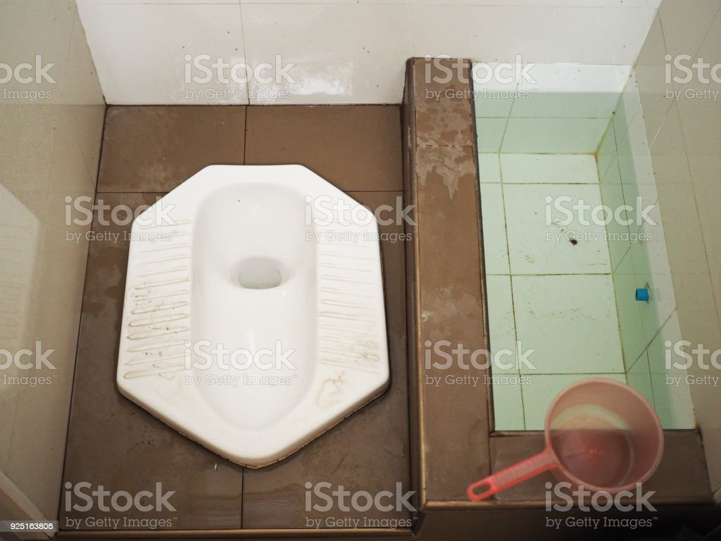 Top View Thai Wet Ceramic Squat Pot Toilet With Water Basin And Bucket Brown Floor