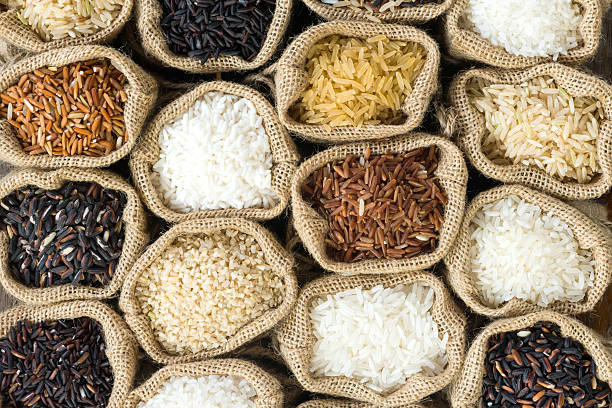Top view Thai's rice collection in burlap bag Top view Thai's rice collection in burlap bag basmati rice stock pictures, royalty-free photos & images