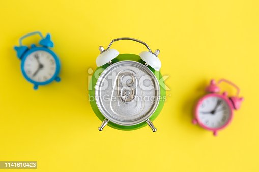 istock Top view time for drink abstract with can and alarm clocks abstract. 1141610423