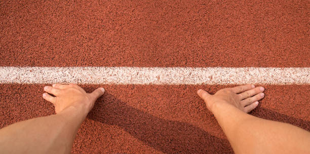 top view touch hands to line start for running on athletics track - carpet runner stock photos and pictures