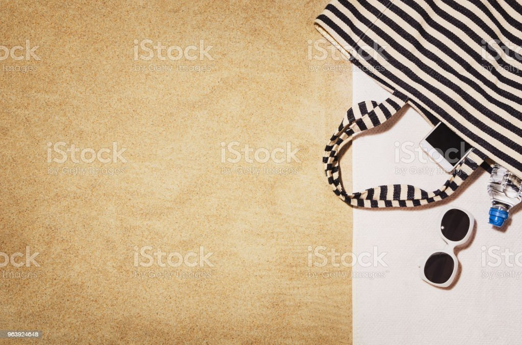 Top view towel on sandy beach. Background with copy space - Royalty-free Above Stock Photo