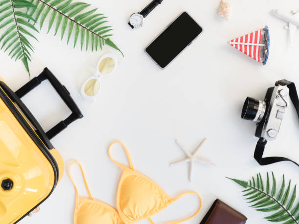 top view travel concept with bikini, luggage, retro camera and outfit of traveler on white wooden background, tourist essentials, vintage tone effect - phone, travelling, copy space imagens e fotografias de stock