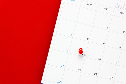 istock Top view valentine's day the red pin mark at calendar 635766360