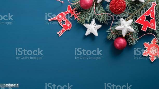 Top view vintage christmas decorations on blue background flat lay picture id1185256818?b=1&k=6&m=1185256818&s=612x612&h=exiczztzg7tffkvhs4 aqdj bleylqob3qbwd9qgjeq=