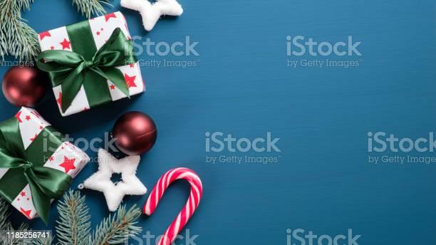 Top view vintage christmas presents on blue background with copy picture id1185256741?b=1&k=6&m=1185256741&s=612x612&h=jz7hfmpoyc7z7zb4mv56wzpzzisppiu4o8ckoixt2tw=