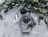 Top view wedding rustic table with eucalyptus. Tableware