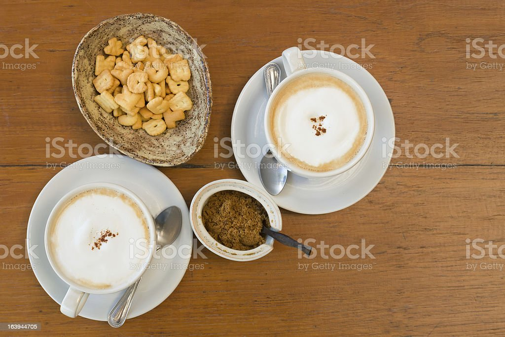 Top view White ceramic cup of coffee and letter Biscuits royalty-free stock photo