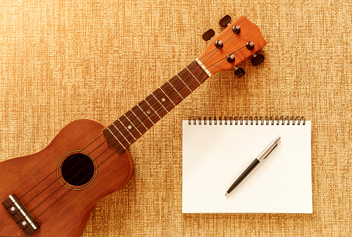 istock Top view with Ukulele on Sofa There are notebooks and pens for d 897655482