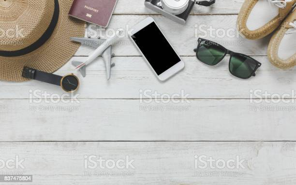 Top view women accessoires to travel conceptwhite mobile on wood picture id837475804?b=1&k=6&m=837475804&s=612x612&h=ycvm 3ne1i04uyepsae4gonbq1rbr31xkmn6uixxctu=