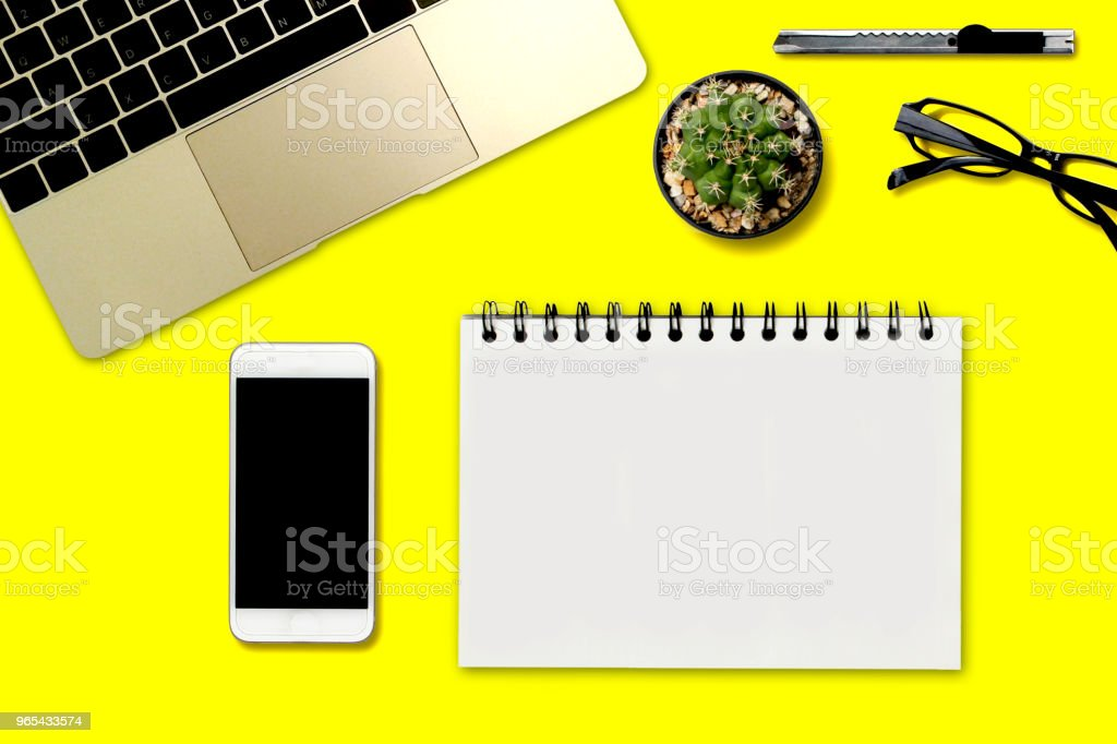 Top view yellow desk and accessories royalty-free stock photo