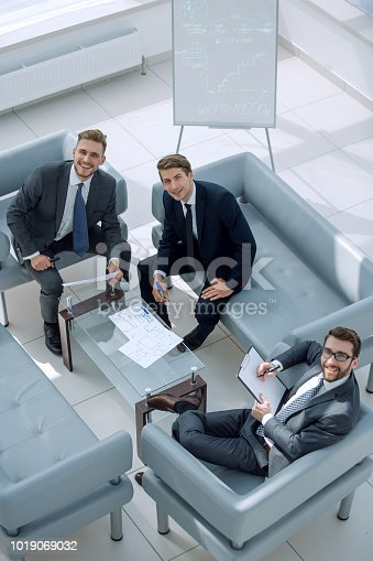 istock top view.business partners sitting in the meeting room 1019069032