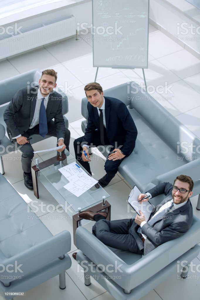 top view.business partners sitting in the meeting room stock photo
