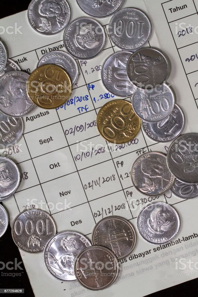 Top View/Flat Lay of Spending Money and Payment Illustrated with coins and membership monthly payment, isolated black stock photo