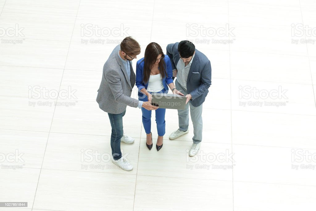 top view.the business team looks at the laptop screen stock photo