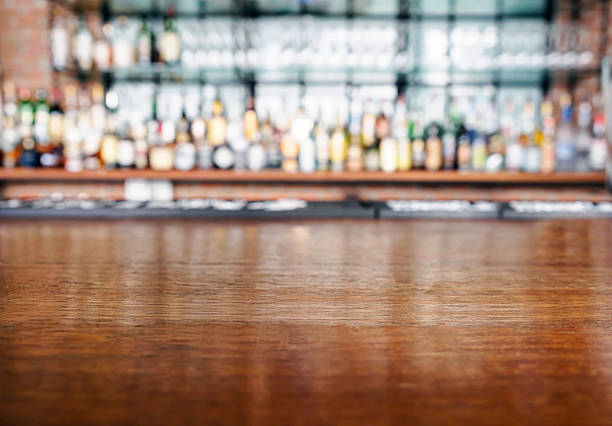 Top wooden table with Bar Blurred Background stock photo