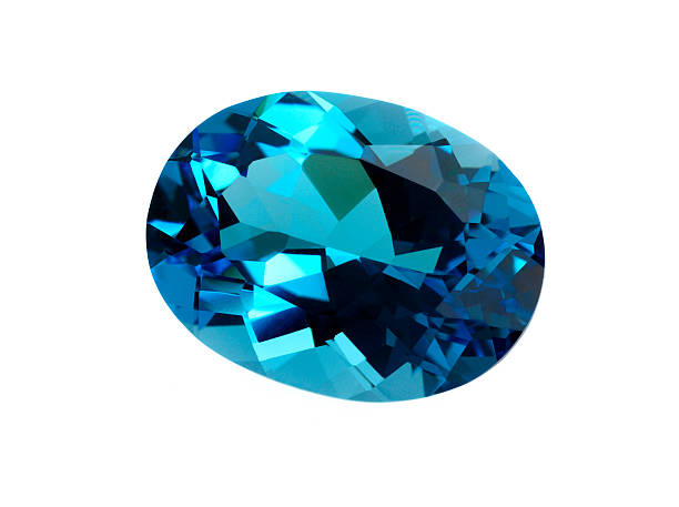 Topaz Gemstone Topaz gemstone isolated on white background. gemstone stock pictures, royalty-free photos & images