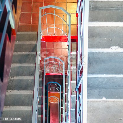 istock Top-Down View of Concrete Stairs, Metal Handrails in High-Rise Residential Building. Emergency Exit Concept 1151309635