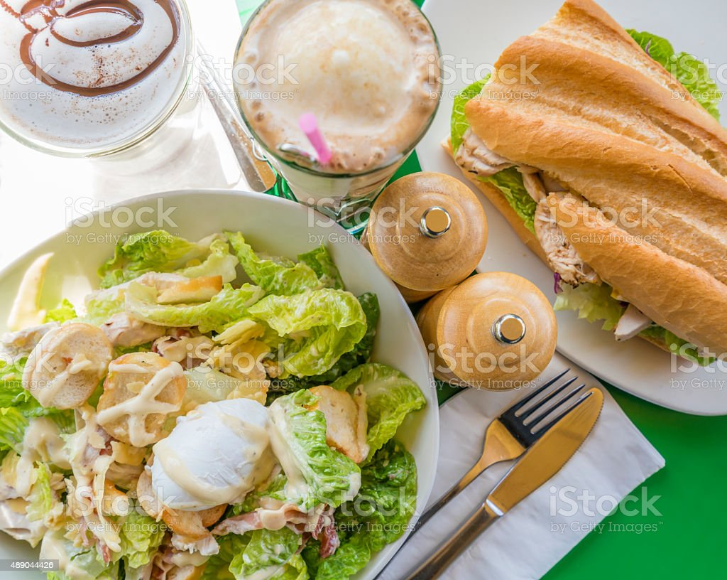 Top-down view of meal with drinks stock photo