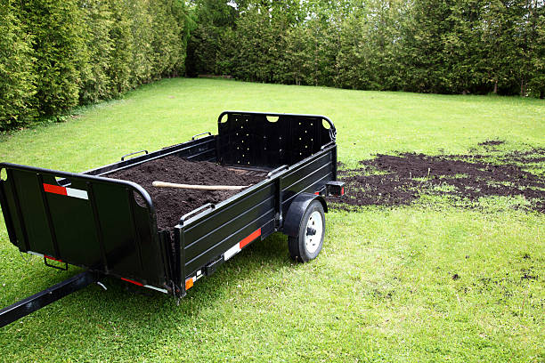 Topdressing Lawn Topdressing grass with soil to improve growth. vehicle trailer stock pictures, royalty-free photos & images