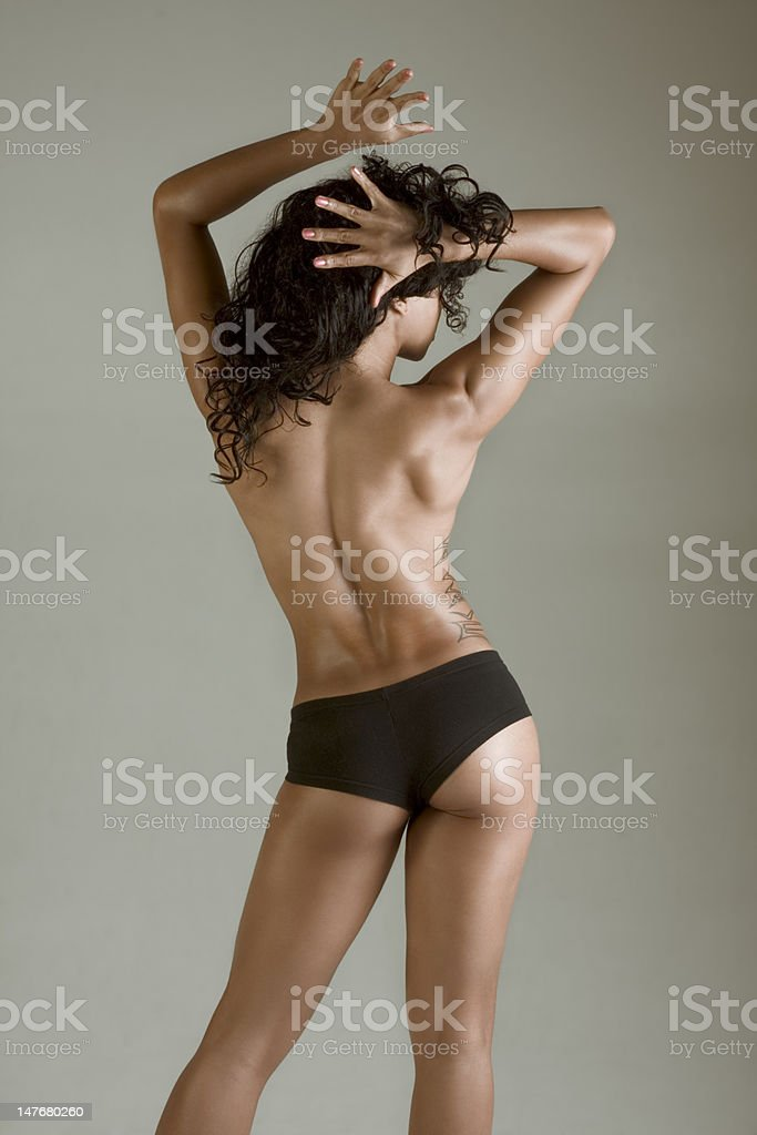 Topless athletic muscular build beautiful woman royalty-free stock photo