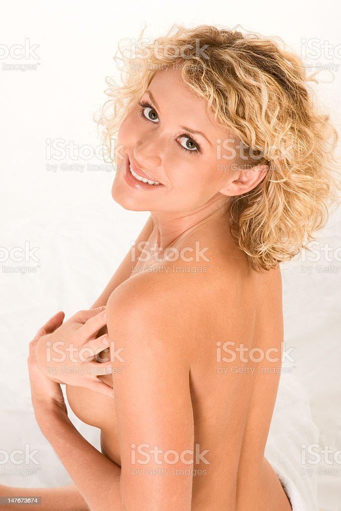 Topless blond woman preparing for spa treatment royalty-free stock photo