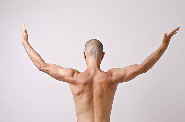 Topless dancer, man stripper posing with his back. stock photo