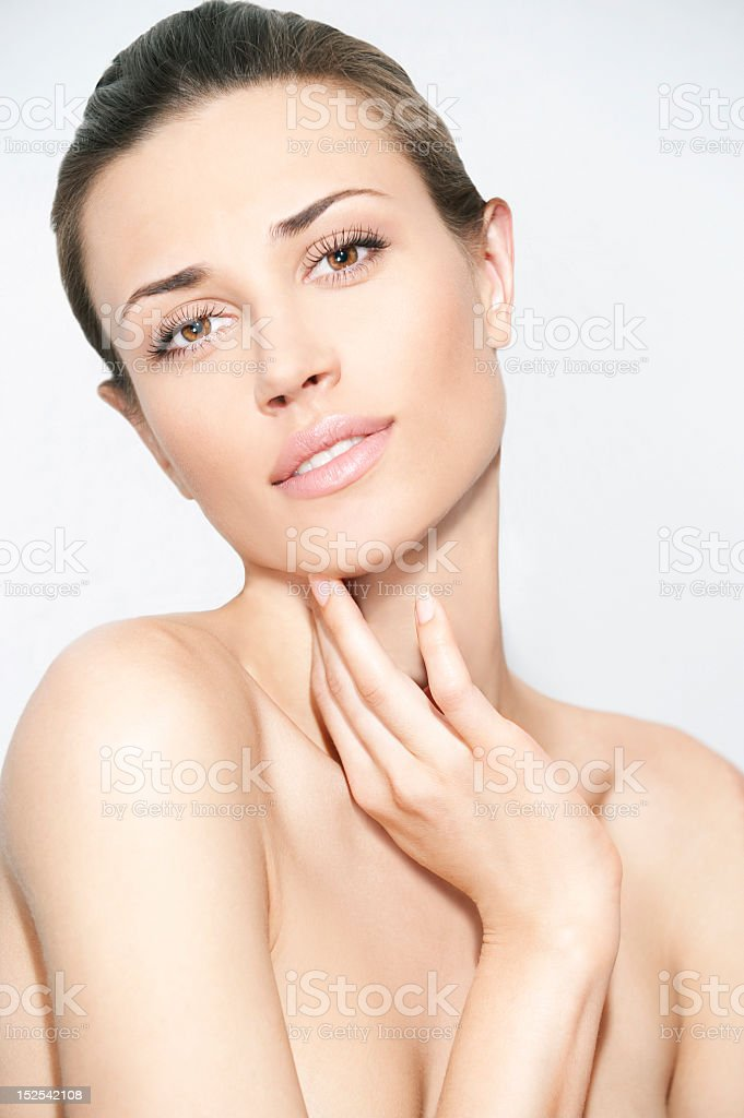 Topless woman strike a natural beauty pose with hand on neck royalty-free stock photo