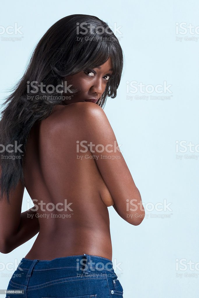 Topless young African American woman in jeans stock photo