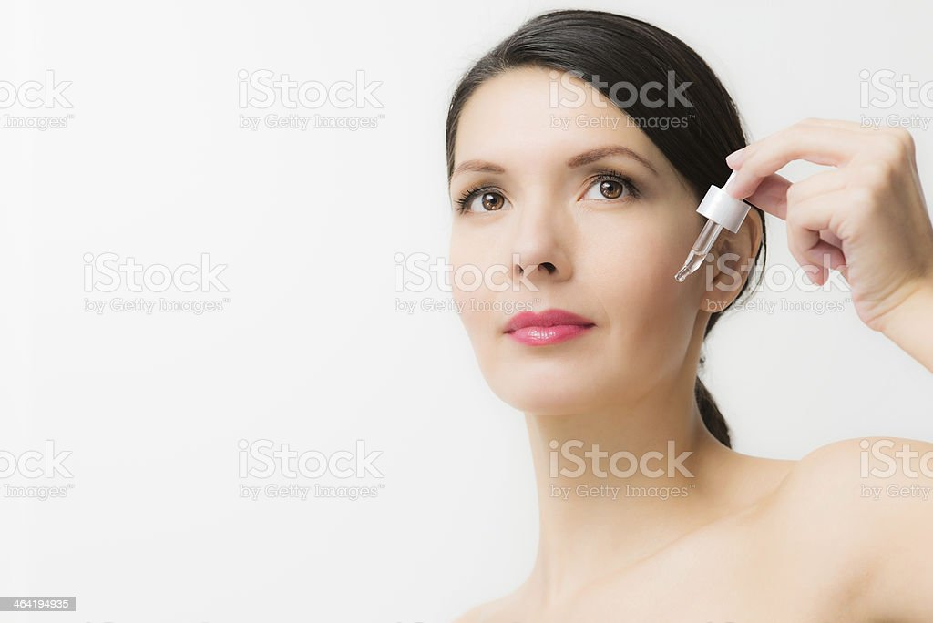 Topless young woman holding a liquid dispenser stock photo