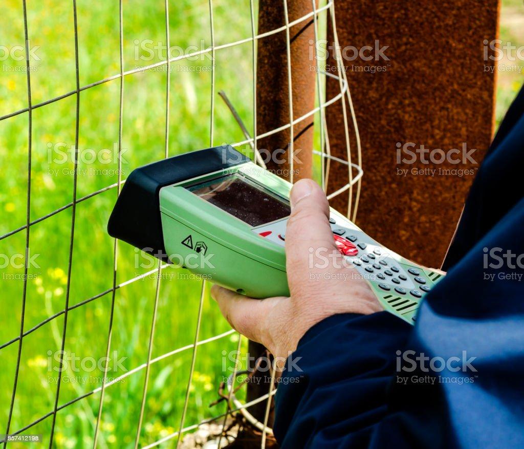 topographic surveyor takes measurements with electronic instrument stock photo
