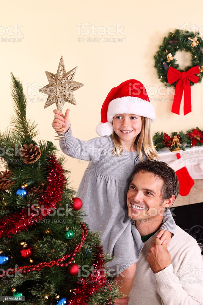 Topping The Christmas Tree royalty-free stock photo