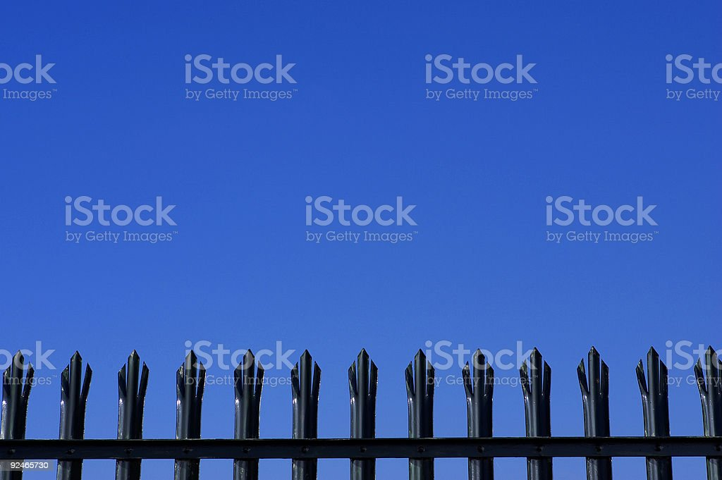 Tops of metal palisade fencing royalty-free stock photo