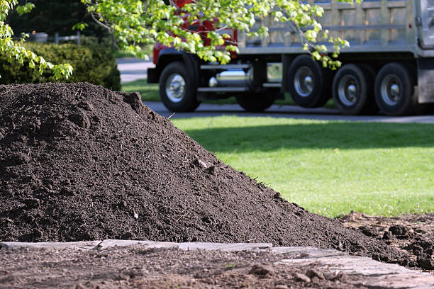 Topsoil Delivery Dump Truck for Residential Landscaping stock photo