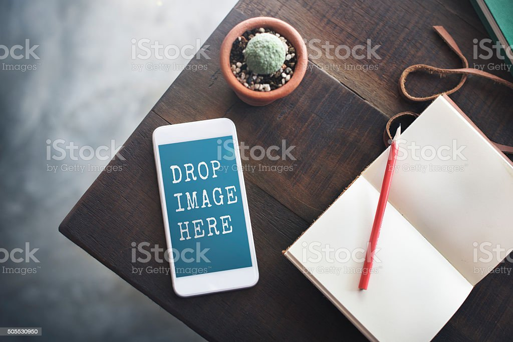 Topview Notebook Mobile Phone Upload Table Concept stock photo
