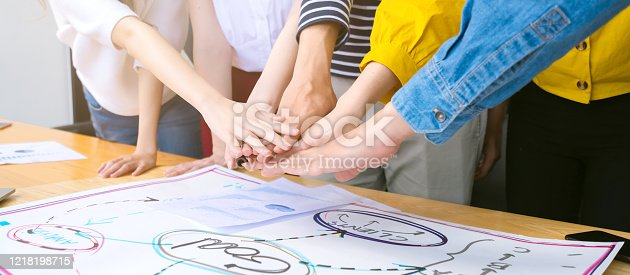 1133505958 istock photo topview of creative agency business brain storm meeting presentation Team discussing roadmap to product launch, presentation, planning, strategy, new business development 1218198715
