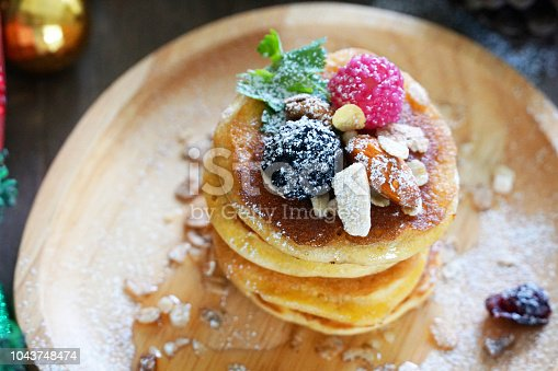 Topview pancake topping with berries and nut , holiday party dessert.