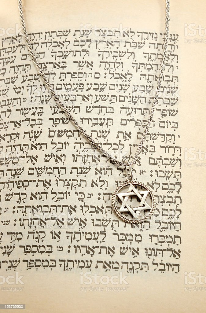 Torah and silver chain with magen david -religious holiday background royalty-free stock photo